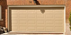 Two Car Garage Door installed beneath modern townhome in Kingwood Texas by Action Garage Doors. They also provide garage door repair, replace and service by highly qualified technicians