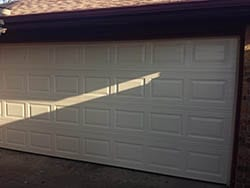 Stratford series residential garage door repaired and opener motor replaced to restore working order in the Dallas Tx