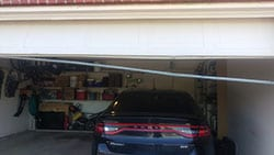 A residential garage door seal at 1249 Whitehorse Dr Lewisville Texas that is broke and in much need of repair by Action Garage Doors professional technicians