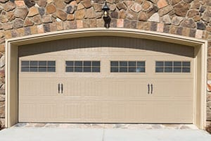 Residential house garage door made from steel that Action Garage Doors installs, repairs, services, and maintains for their customers in the Colleyville Texas area a suburb of the Dallas Fort Worth metro area