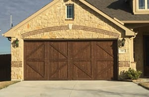A beautiful residential custom wood two car garage door install and repair in Mansfield Texas by the professionals at Action Garage Doors