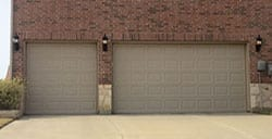 Action Garage Doors is the contractor responsible for this professional install and repair of this custom three car garage doors in Frisco Texas