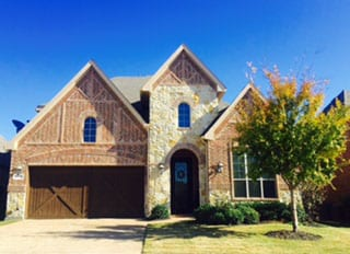 Action Garage Doors is the premier install and repair professionals for custom wood two car garage doors in homes in Trophy Club Texas