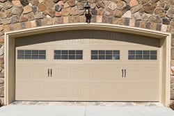 Residential home and commercial steel, aluminum, and wooden garage doors repaired, replaced, and installed by Action Garage Doors of Cypress Texas a suburb of Houston