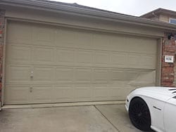 This residential home at 9130 Tampas Ln in Dallas Texas was damaged in two panels by car parking in driveway and Action Garage Doors did the repairs