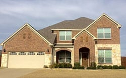 This is a beautiful residential two car steel garage door was installed and repaired in Frisco Texas by technicians from Action Garage Doors