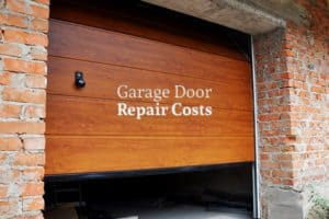 "A partially closed wooden garage door with the words ""Garage Door Repair Costs"""