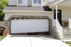 broken white double garage door that won't close all the way
