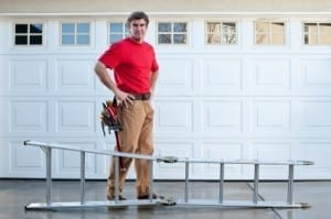 garage door repairman with ladder
