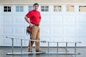 garage door repairman with ladder