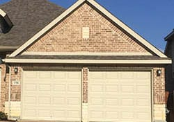 This Grand Prairie Texas home received two single car steel garage door installed and repaired by technician Ryan Beck of Action Garage Doors