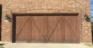 Half bucks, carriage style wooden garage install for new home in Flower Mound Texas by the experts at Action Garage Door