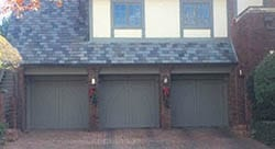 Three custom wood single car garage doors installed and repaired in Highland Park Texas by a highly qualified technician from Action Garage Doors