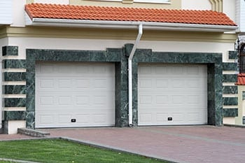 Action Garage Doors install, repair, service, and maintenance of steel garage doors for 2 cars with a marble fascia in Euless Texas a suburb of Fort Worth
