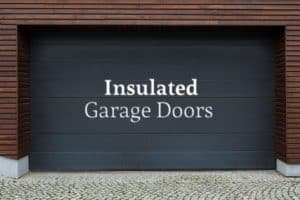 """A steel garage door that's been painted black with the words """"Insulated Garage Doors"""""""
