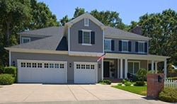 Amazing double and single car garage door installed on a luxury home by Action Garage Doors of Kingwood Texas. Additionally they service, repair, and maintain garage doors