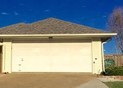 Action Garage Door technician Greg Beck installed and repaired this two car garage door on this residence in Garland Texas
