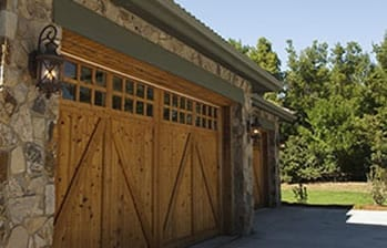 Lewisville Texas residential wood garage door installation and repair by Action Garage Doors Dallas Fort Worth professionals