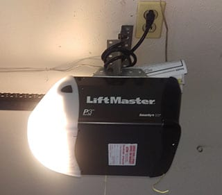 This residential home on Harbinger Lane in Dallas Texas called Action Garage Door to install a new Liftmaster garage door opener on this steel door