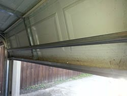 At 6438 Los Altos Dr Mesquite Texas Action Garage Doors technicians replaced and repaired a garage door panel and seal