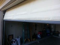 Technician R Floutin of Action Garage Doors installed and repaired this garage door with a new panel and seal at a home in Mesquite Texas