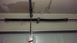 This residential home in Carrollton Texas suffered a garage door spring breakage and Action Garage Doors was called to repair and replace the spring and cable