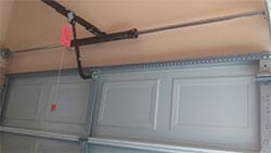 Action Garage Doors highly qualified technicians installed a garage door opener and torsion bar spring in McKinney Texas