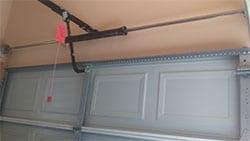 Action Garage Doors highly qualified technicians installed a garage door opener and torsion bar spring in McKinney Texas
