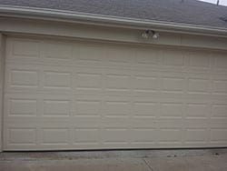 Action Garage Doors top technicians were called to this residential home to install a new steel garage door in Arlington Texas