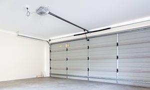 Residential empty double car garage with automatic door opener