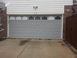 A window garage door with broken windows in need of repair or install that Action Garage Doors sent Alfredo their highly qualified technician