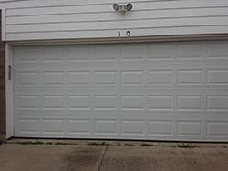 A seemingly peaceful residential home in Plano Texas was called upon to repair this steel garage door by Action Garage Doors technician Ryan Beck