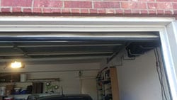 A residential garage door seal at 1249 Whitehorse Dr Lewisville Texas that has been repaired by Action Garage Doors professional technicians