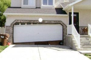 Residential Garage Door That Has A Track Problem And Is Repaired By Action Garage  Doors Fort
