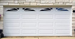 Double white american home and commercial garage doors installed, repaired, and serviced by Action Garage Doors in Missouri City Texas a suburb of Houston
