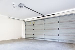 Residential two garage doors installed plus Action Garage Doors services, repairs, and maintains the in Colleyville Texas a suburb of Dallas Fort Worth metro area