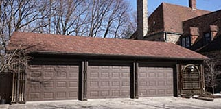 Charmant Garage Door Repair In Round Rock, TX. Action Garage Doors Installed The  Doors On This Three Car Garage Style Home. They Also