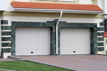 Residential steel and wood garage doors repair, install, service, and maintenance by background checked professionally trained technicians in Forest Hill Texas Action Garage Doors