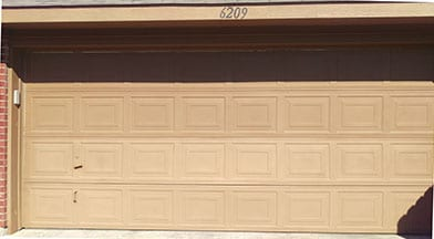 An Older Residential Home That Has A Very Aged Garage Door Needed Repairs  In Mckinney Texas