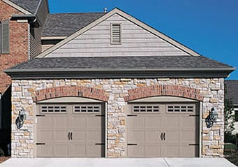 Action Garage Doors Openers residential steel double car garage door install and repair in Lewisville Texas a suburb of Dallas and Fort Worth