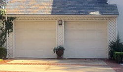 Action Garage Doors installs and repairs custom wood two car garage doors for residential and commercial applications in University Park Texas