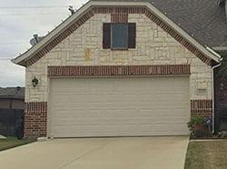 Action Garage Doors installed this beautiful custom steel garage door and repairs as well in the Waxahachie Texas area