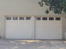 Action Garage Doors was called to render aid at this home in Highland Park Texas single car steel garage doors for repair, replace, and install