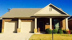 Two beautiful single car garage doors installed to repair aging garage doors on a home in Haslet Texas by Action Garage Doors of Plano