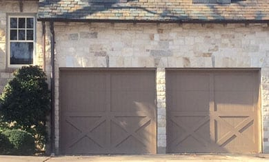 Custom residential wood garage doors installed, repaired, and serviced in University Park Texas by Action Garage Doors of Plano